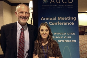 HDI director Harold Kleinert congratulated Ashley Candelaria Alumbaugh, who received the prestigious 2013 Anne Rudigier Award.